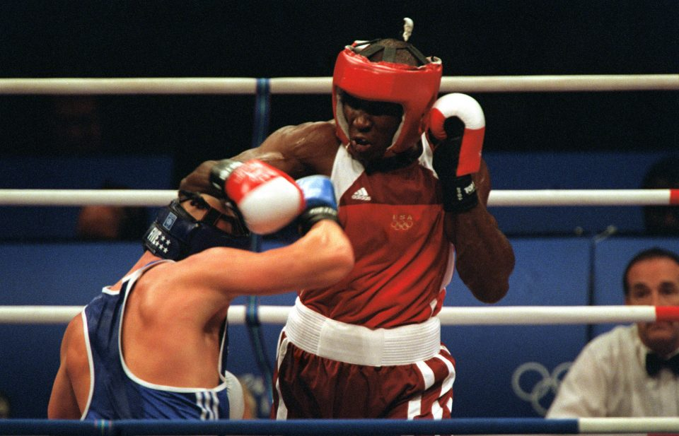 Straight on, medium shot of US Army Staff Sergeant Olanda Anderson (Red) as he tries to land a punch against Rudolf Kraj, of the Czech Republic, in the Men's 81 Kilogram weight class at the 2000 Olympic games in Sydney, Australia, on September 24th, 2000. SSG Anderson is from the US Army's World Class Athlete Program, and he lost to Kraj by one point, 12-13.