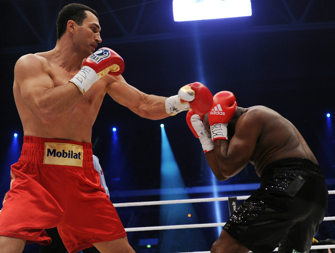 Ukrainian heavyweight boxing world champion Wladimir Klitschko (L) fights with French challenger Jean-Marc Mormeck in the IBF, IBO, WBO and WBA title bout at the Esprit arena in the western German city of Duesseldorf on March 3, 2012. AFP PHOTO / PATRIK STOLLARZ (Photo credit should read PATRIK STOLLARZ/AFP/Getty Images)